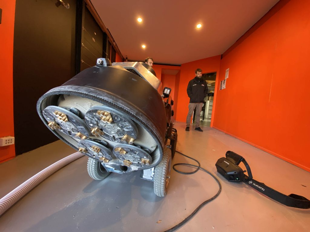 Elite Concrete Floors - concrete polishing machine ready to grind a floor